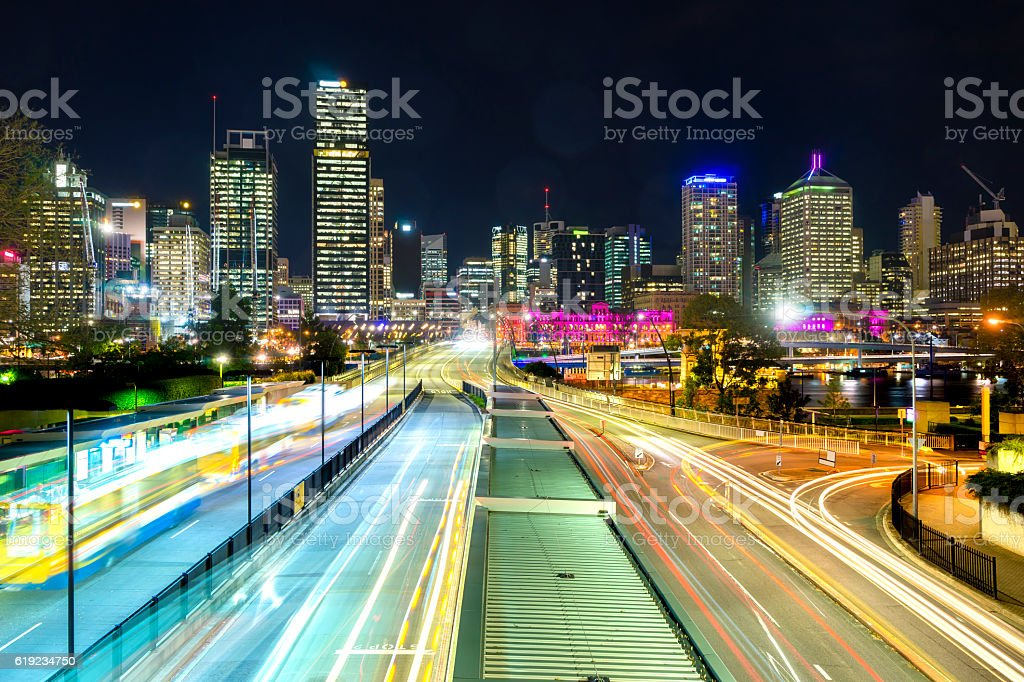 Bus station and modern buildings at night stock photo