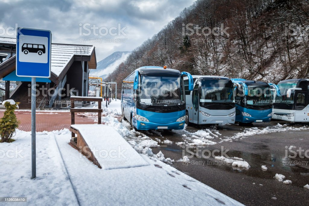 Bus station near the mountain forest at winter стоковое фото