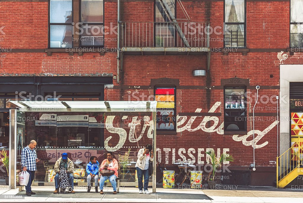 Bus Stop at Harlem, Next to the Streetbird Rotisserie stock photo