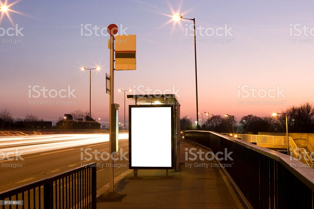Bus Stop billboard at dusk (+Clipping Path) royalty-free stock photo