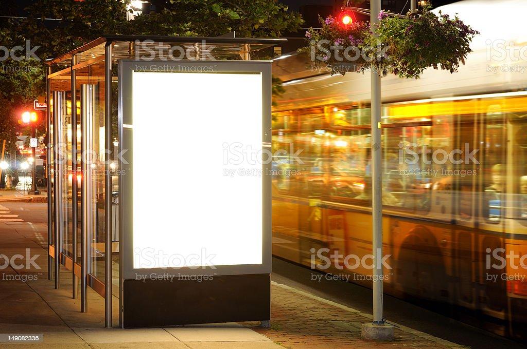 Bus Stop Billboard at Night stock photo