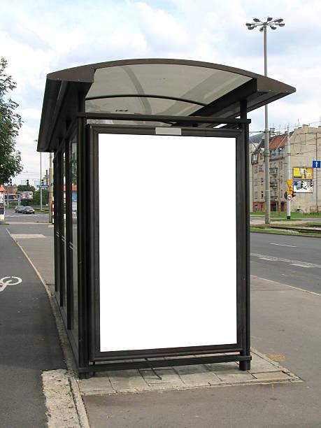 Bus stop billboard on city street work path on ad] stock photo