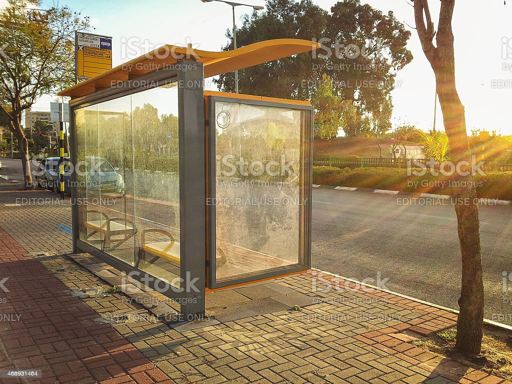 Bus stop flooded by sunset stock photo