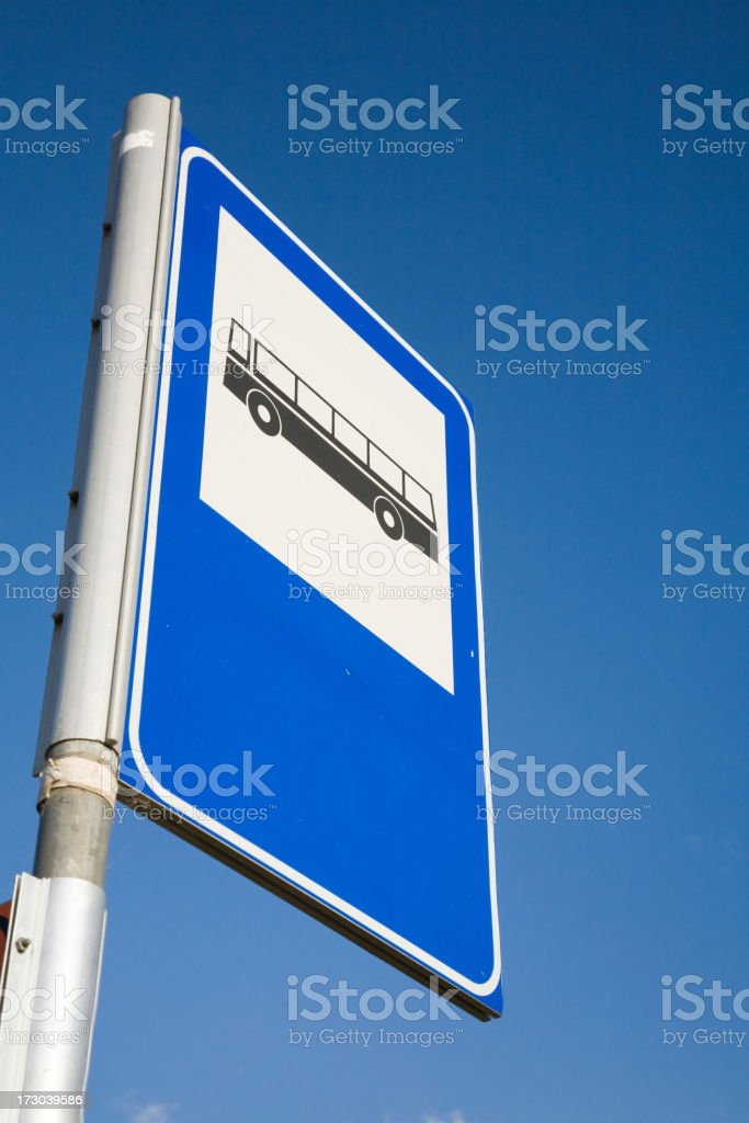 bus stop sign on the sky stock photo