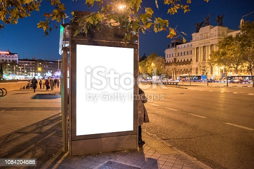 istock Bus stop with billboard at night 1084204588