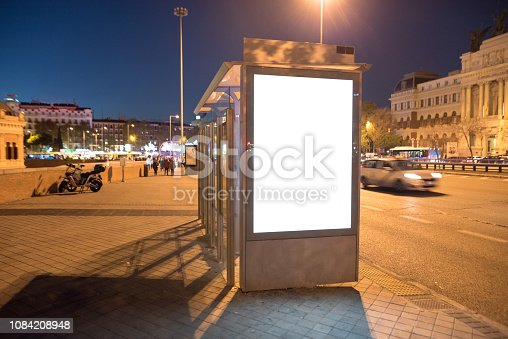 istock Bus stop with billboard at night 1084208948