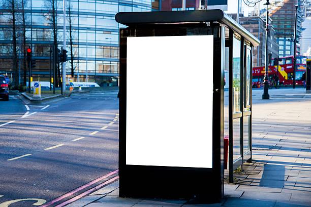 bus stop with billboard - bushalte stockfoto's en -beelden
