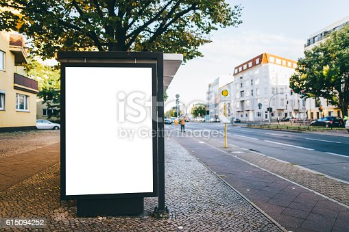 istock Bus stop with billboard 615094252