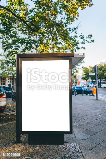 istock Bus stop with billboard 615094908