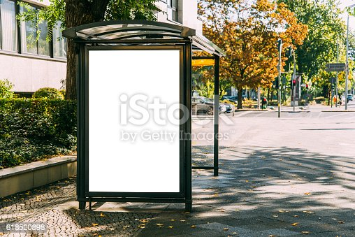 istock Bus stop with billboard 618520898