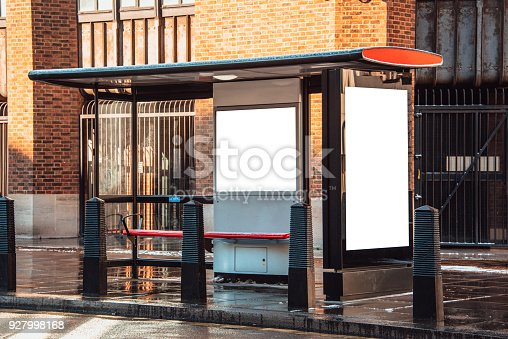 693455040 istock photo Bus stop with billboard 927998168