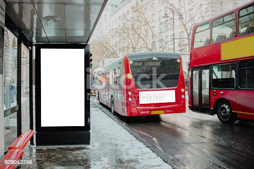 693455040 istock photo Bus stop with billboard 929043746