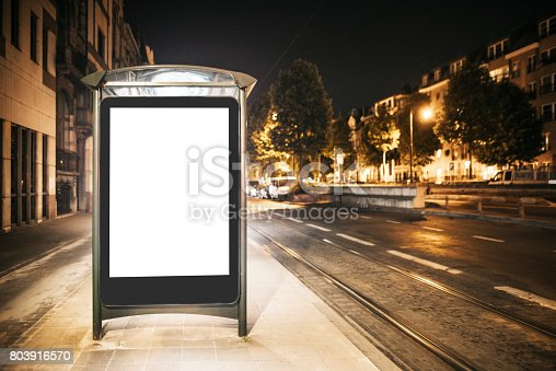 istock Bus stop with blank billboard at night 803916570