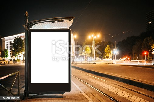 istock Bus stop with blank billboard at night 803916596