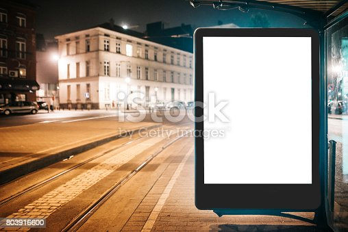 istock Bus stop with blank billboard at night 803916600