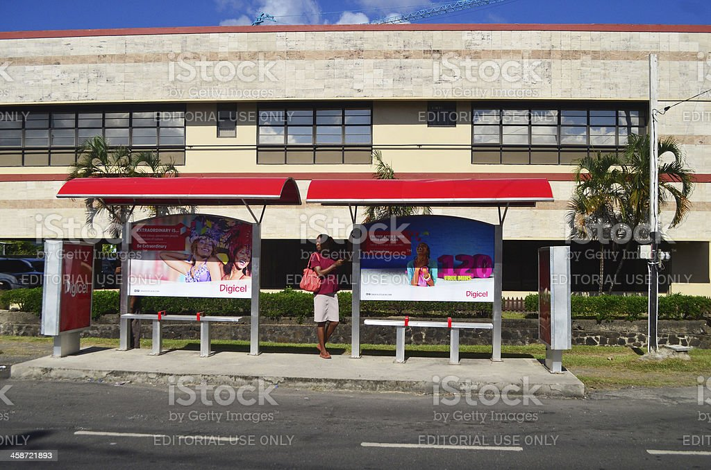 Bus Stop with Digicel advertising material stock photo