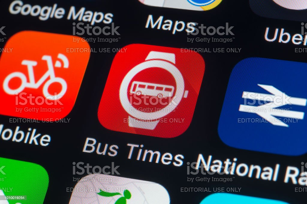 Bus Times, National Rail, Mobike and other travel Apps on iPhone screen stock photo