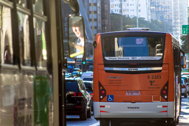 Bus travels through the exclusive strip of Paulista Avenue stock photo