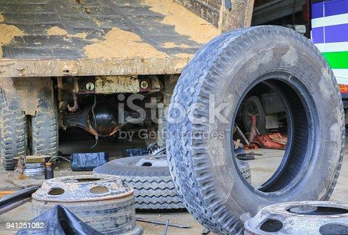 istock bus wheel rubber waiting to repair in garage 941251082