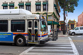 Orange, CA / USA – November 14, 2019: City bus with bicycles on front rack, operated by the Orange County Transit Authority, in route in the City of Orange, California.