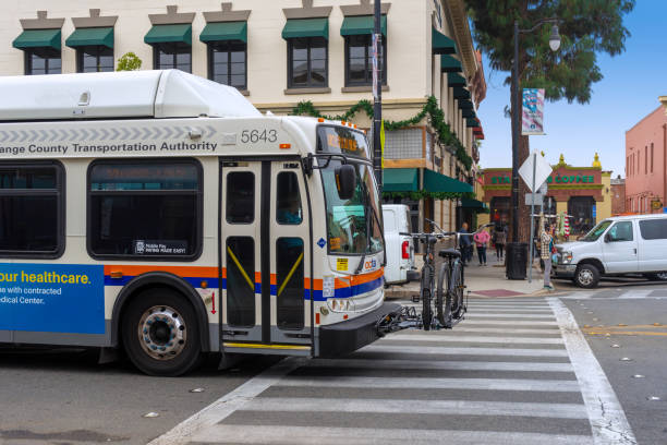 OCTA bus with bicycle rack in the City of Orange, California stock photo