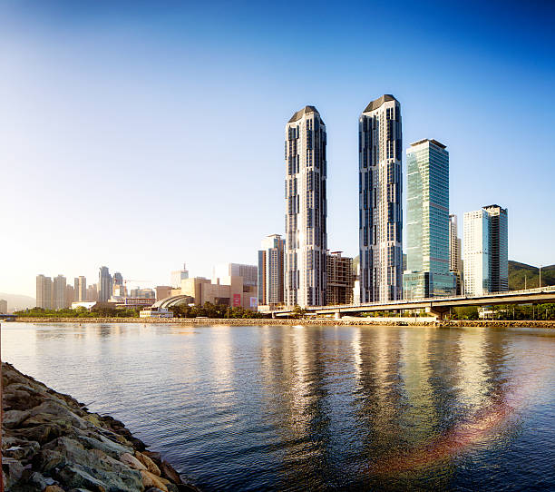 busan centum city skyline at sunset with river reflections - 釜山 ストックフォトと画像