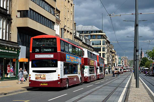 Buses and people on Princess Street in Edinburgh stock photo