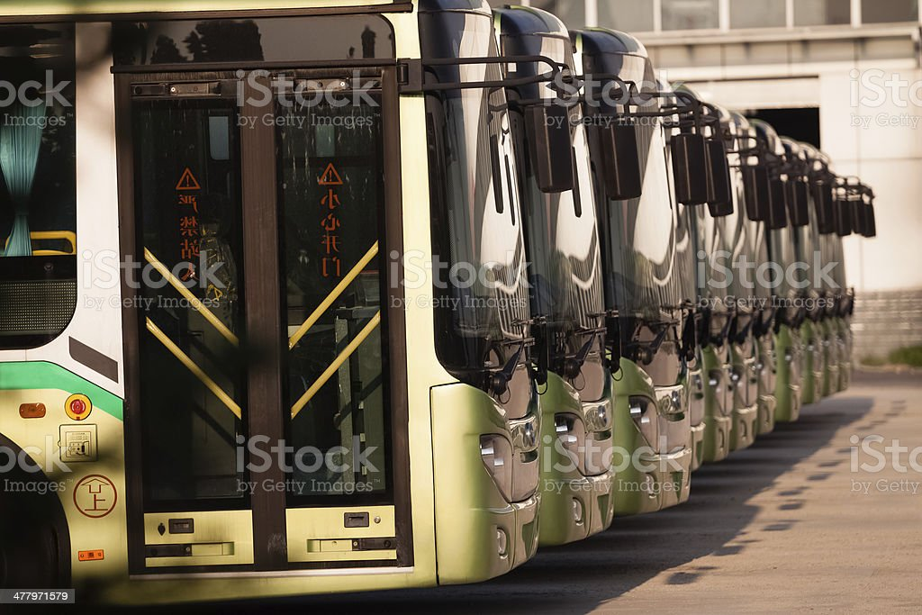 Buses in a row stock photo