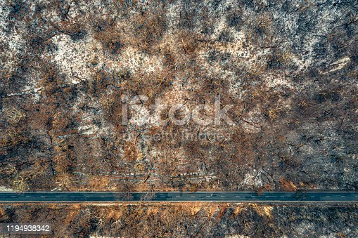 Aerial view of Australian bush fire destruction with empty road.