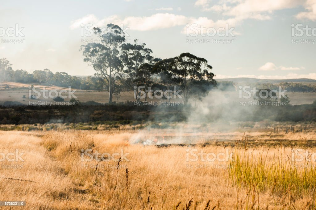 Bush fire in a country town. stock photo