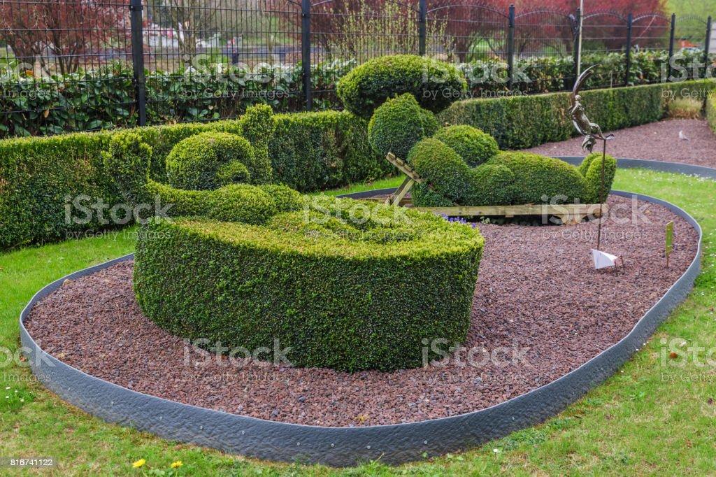 Bush sculpture in park - Durbuy Belgium stock photo