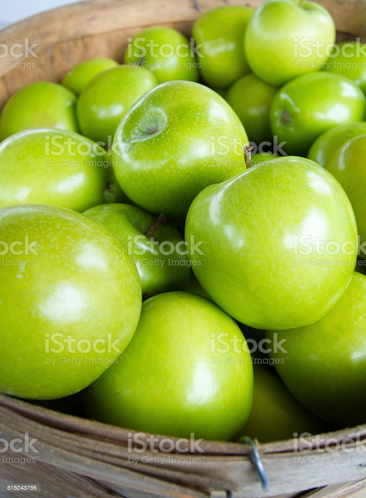 Bushel Basket of Granny Smith Apples (Close-Up) stock photo