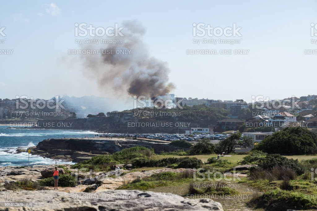 Bushfire with smoke at Dunningham Reserve at the coast stock photo