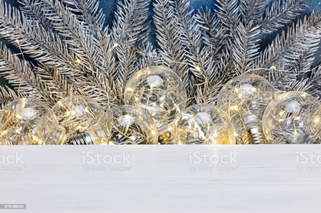 Bushy Silver Christmas Tree Branches And Old Decorative Lights On