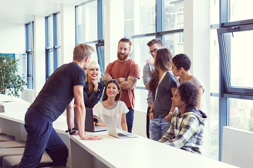 Busienss Team Brainstorming In An Office Stock Photo - Download Image Now