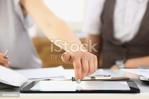 1063657732 istock photo Businees woman toch on tablet pc finger display 825596802
