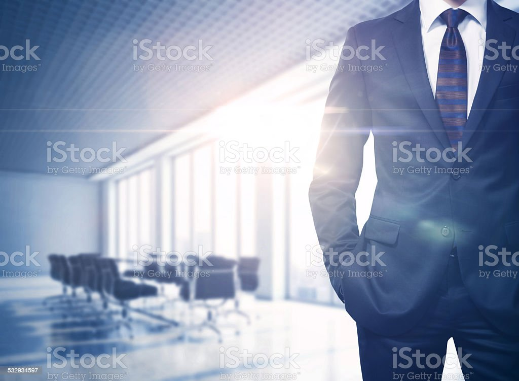 Busineesman in sunny office stock photo