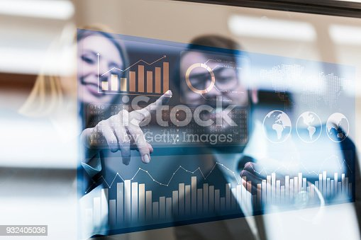 istock Busines couple discussing business profit on a modern interface 932405036