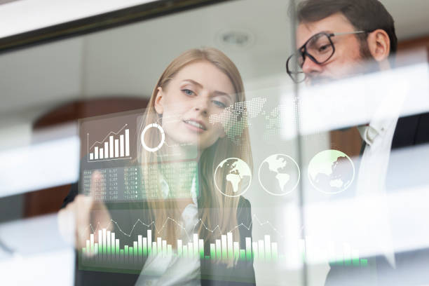 Busines couple discussing business profit on a modern interface Busines couple discussing business profit on a modern interface infographic stock pictures, royalty-free photos & images