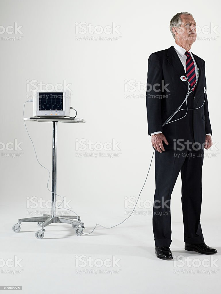 Businesman and pulse trace machine royalty-free stock photo