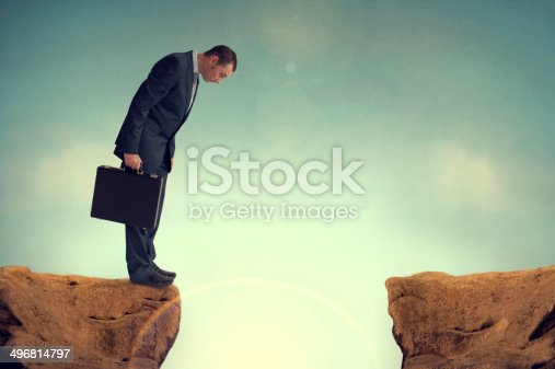 businessman nervously facing an obstacle challenge