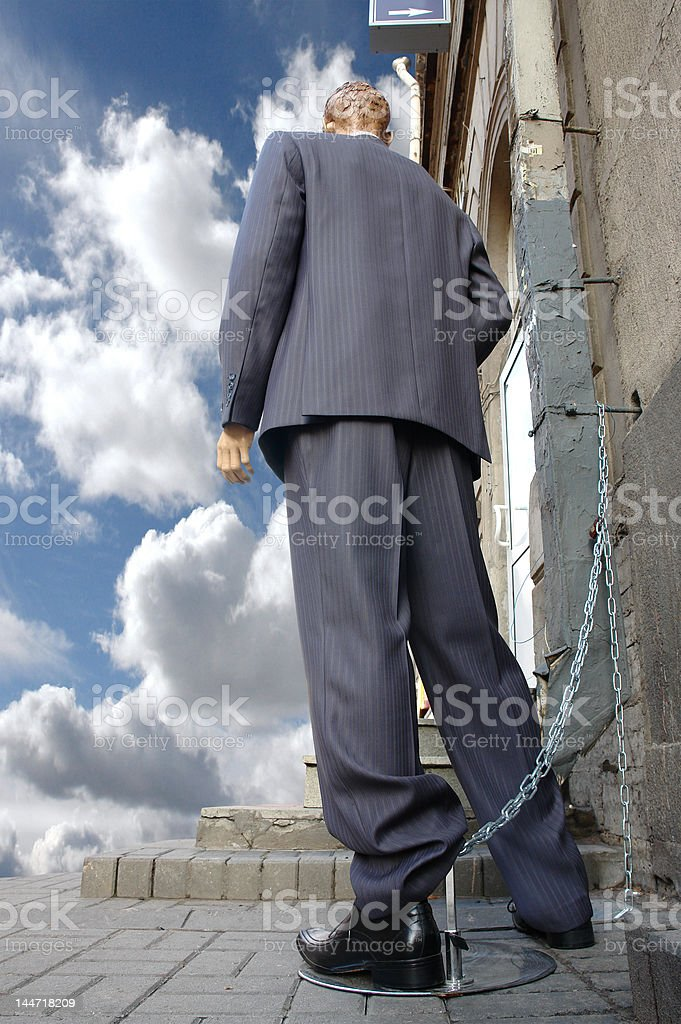 businesman tied up at the doors royalty-free stock photo