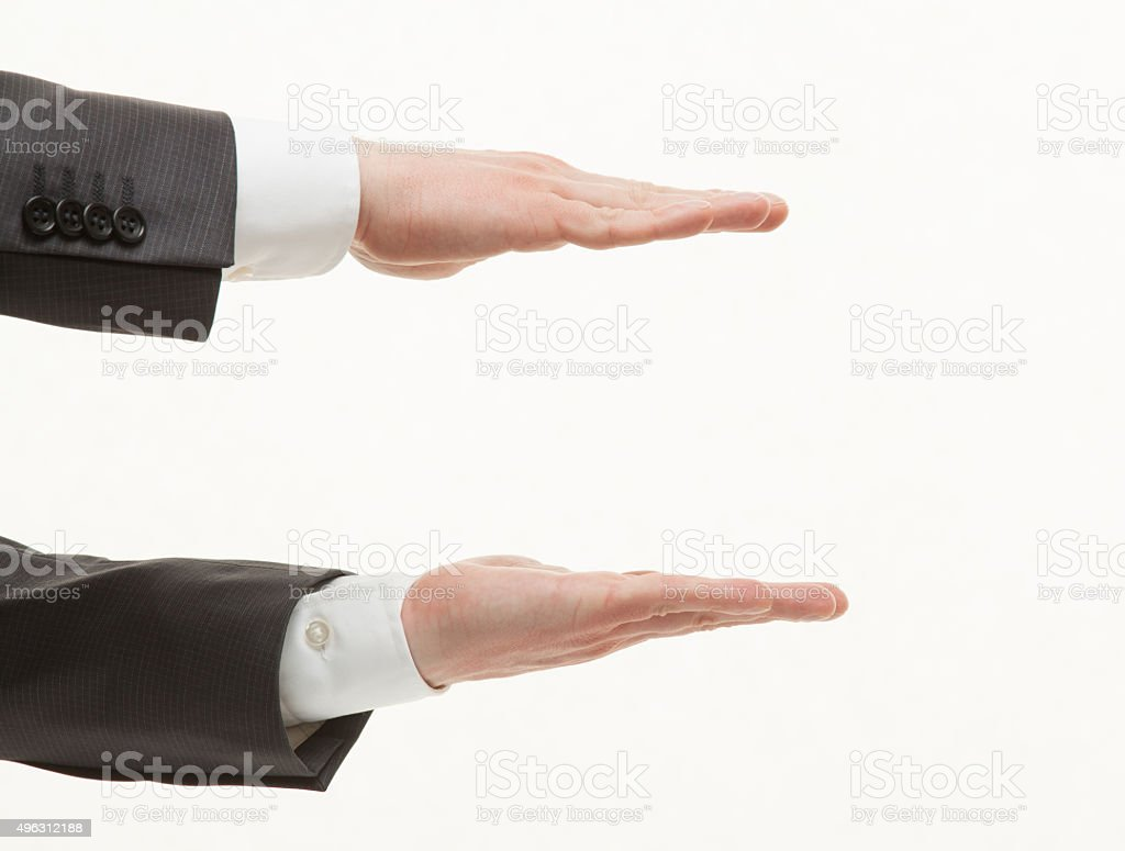 Businesman's palms showing middle size stock photo