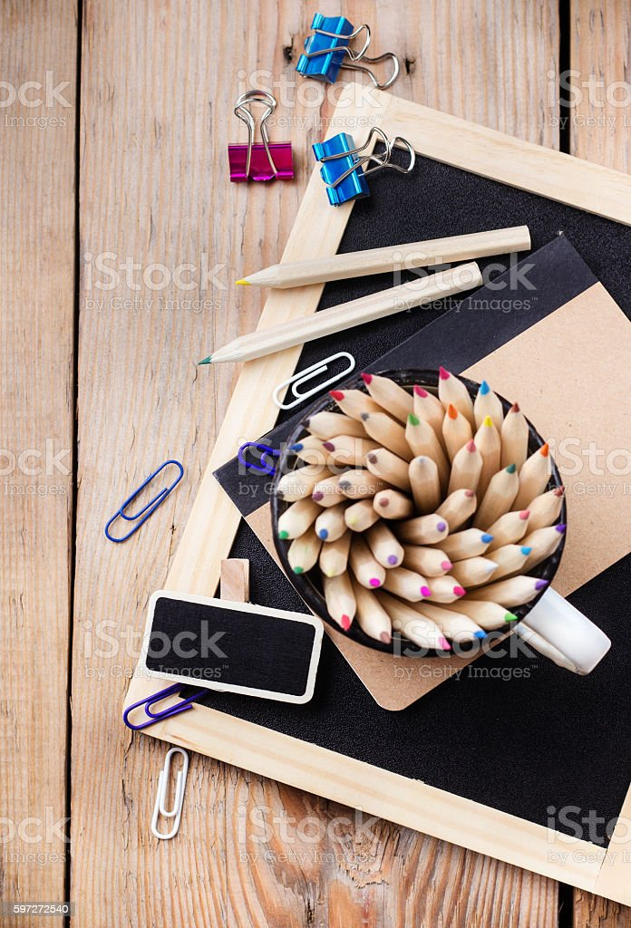 Business accessories, supplies, mug with pencils on rustic wooden table royalty-free stock photo
