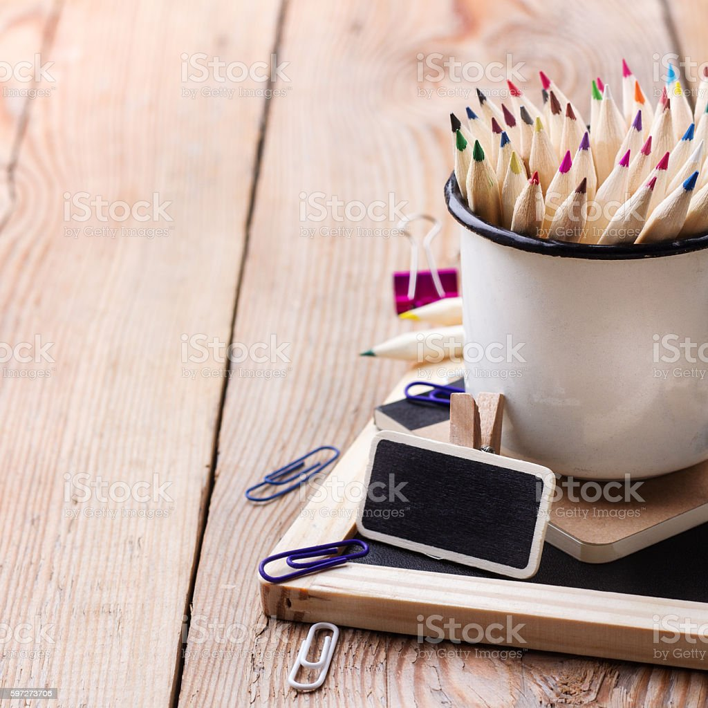 Business accessories, supplies, mug with pencils on rustic wooden table Lizenzfreies stock-foto
