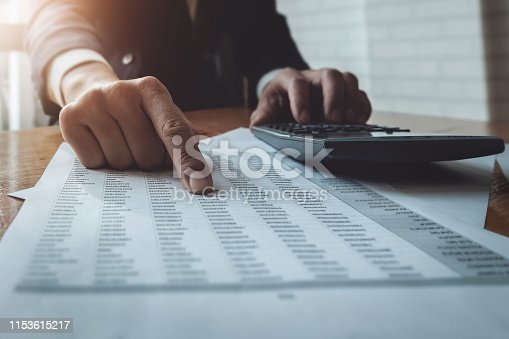 istock Business accounting , Business man using calculator with calculate stock market data chart, tax and budget paper in office.  accounting auditor concepts. 1153615217