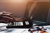 istock Business accounting, Business man using calculator with computer laptop, budget and loan paper in office. 939923434