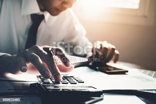 941729686 istock photo Business accounting, Business man using calculator with computer laptop, budget and loan paper in office. 939923480