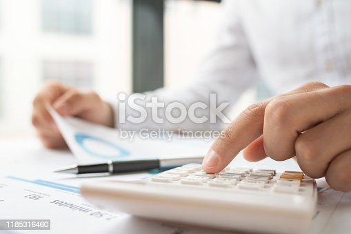 941729686 istock photo Business accounting concept, Business man using calculator 1185316460