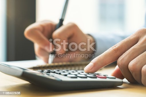 941729686istockphoto Business accounting concept, Business man using calculator 1188402638